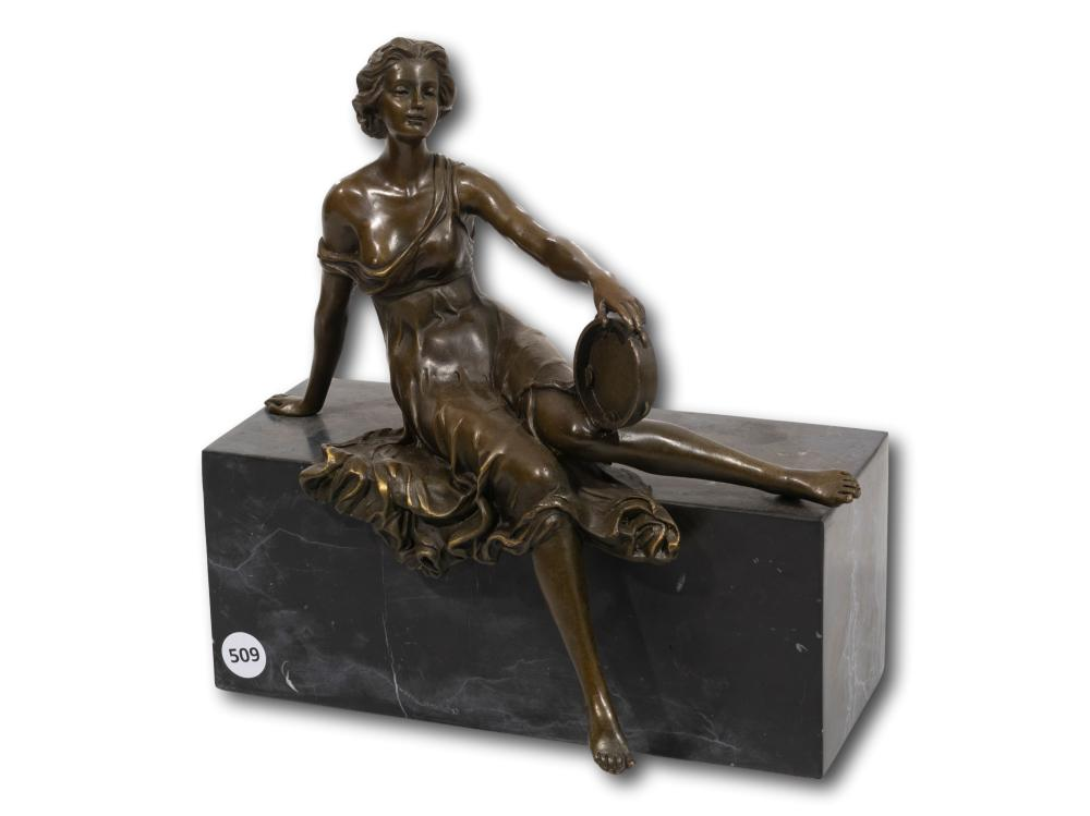 A Bronze of a Seated Lady with a Tambourine, 26cm including base