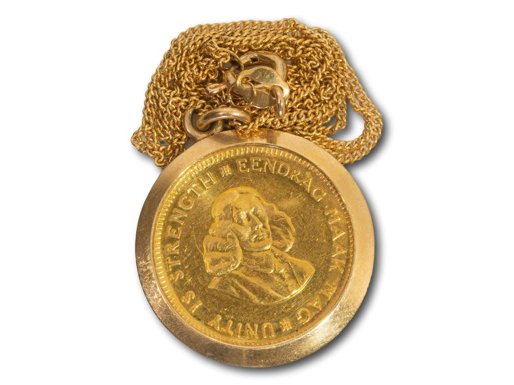 A 1972 Gold 1 Rand Coin Mounted on a Gold Chain, total weight 7.8g