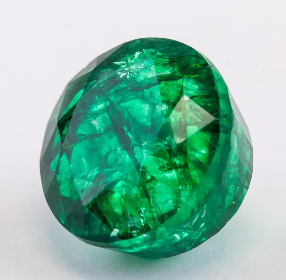 Lot 339: 12.55 Ct Natural Cut Green Emerald GGL Certificate