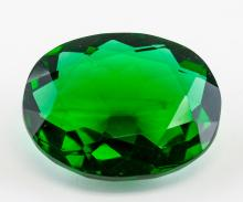 Lot 343: 112.76 Ct Oval Cut Emerald Green Gemstone