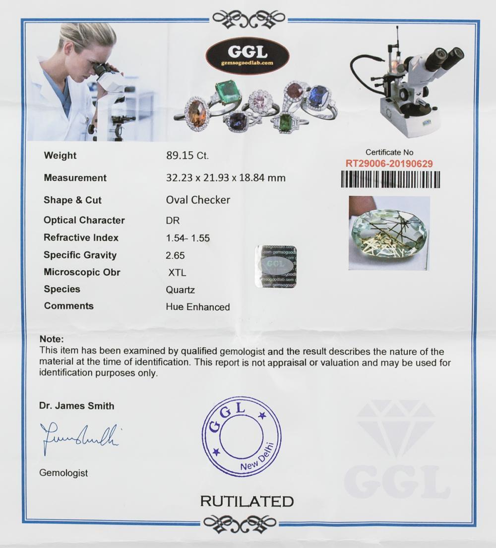 Lot 352: 89.15 Ct Oval Checker Rutilated Quartz Gemstone
