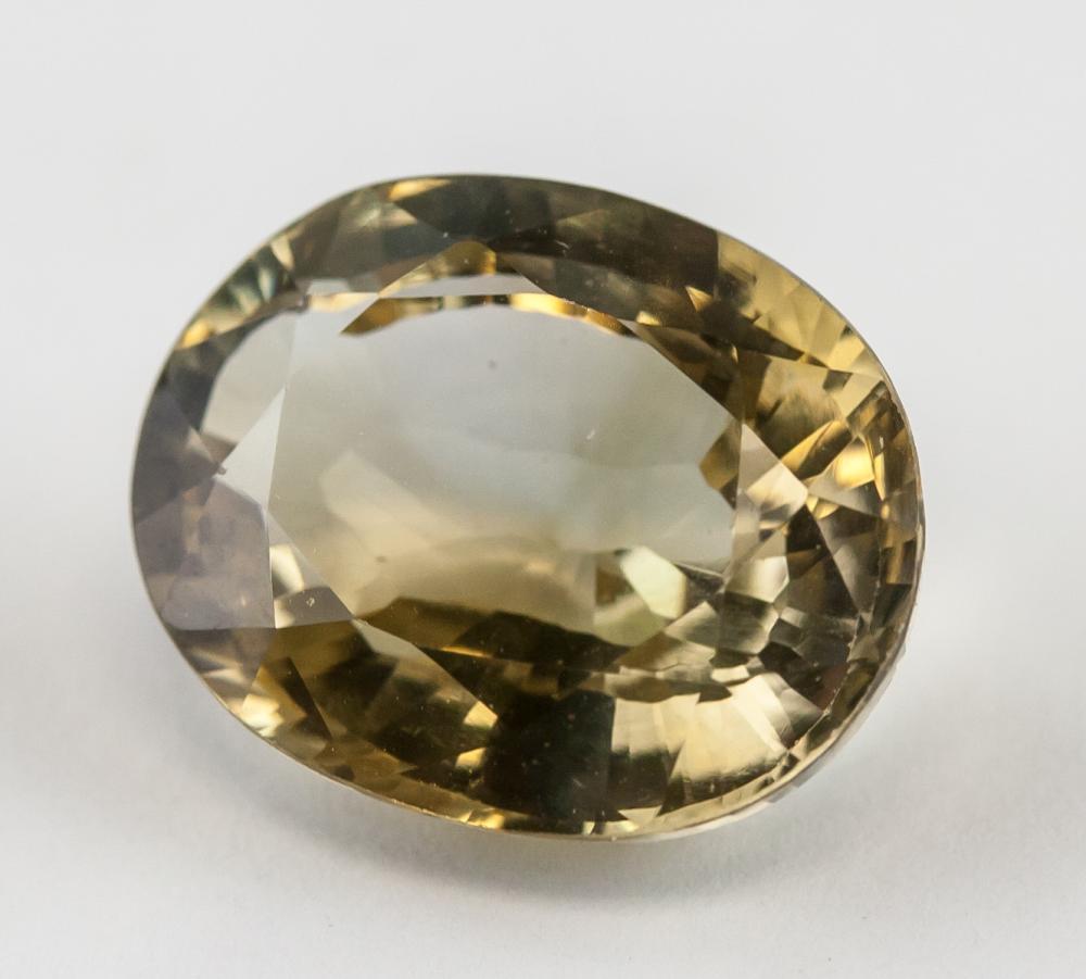 Lot 357: 11.70 Ct Oval Cut Yellow Sapphire Gemstone