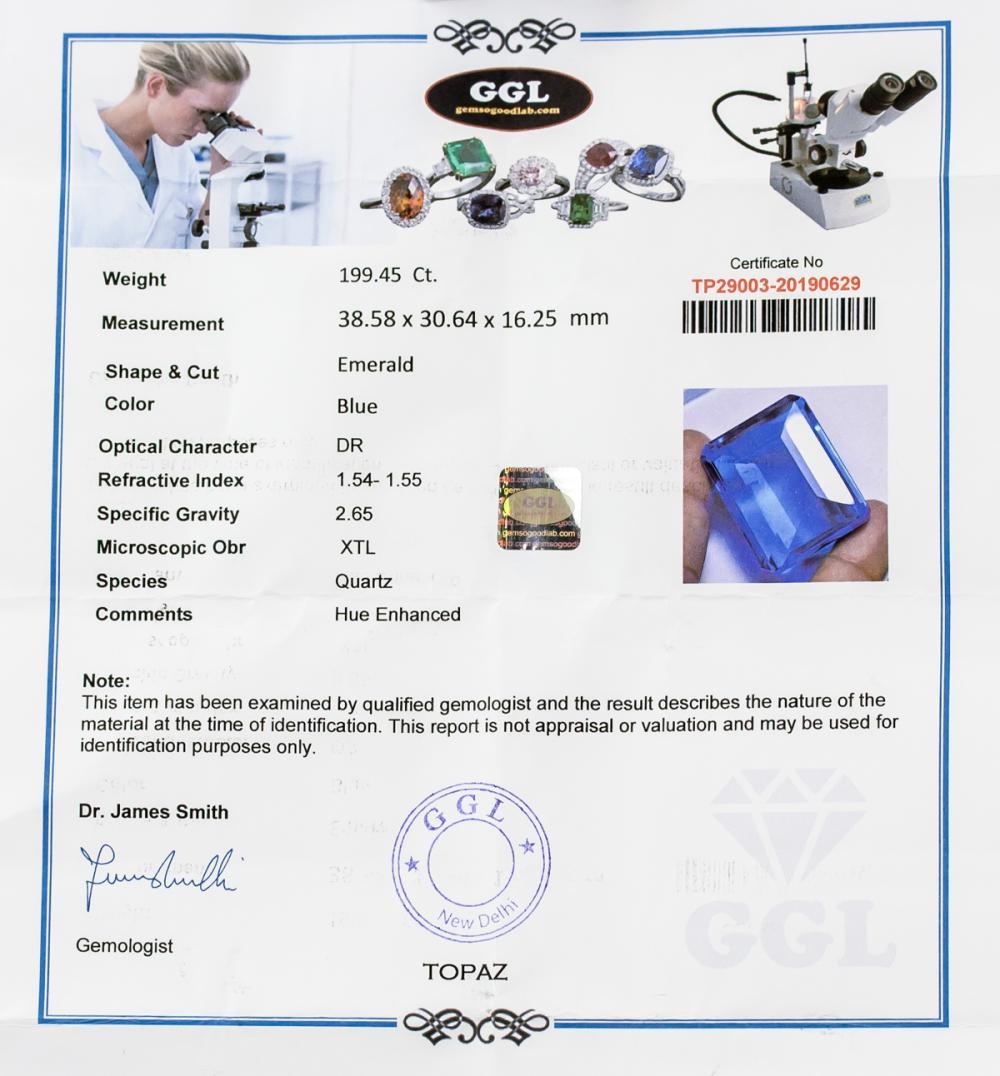 Lot 368: 199.45ct Emerald Cut Blue Topaz GGL Certificate