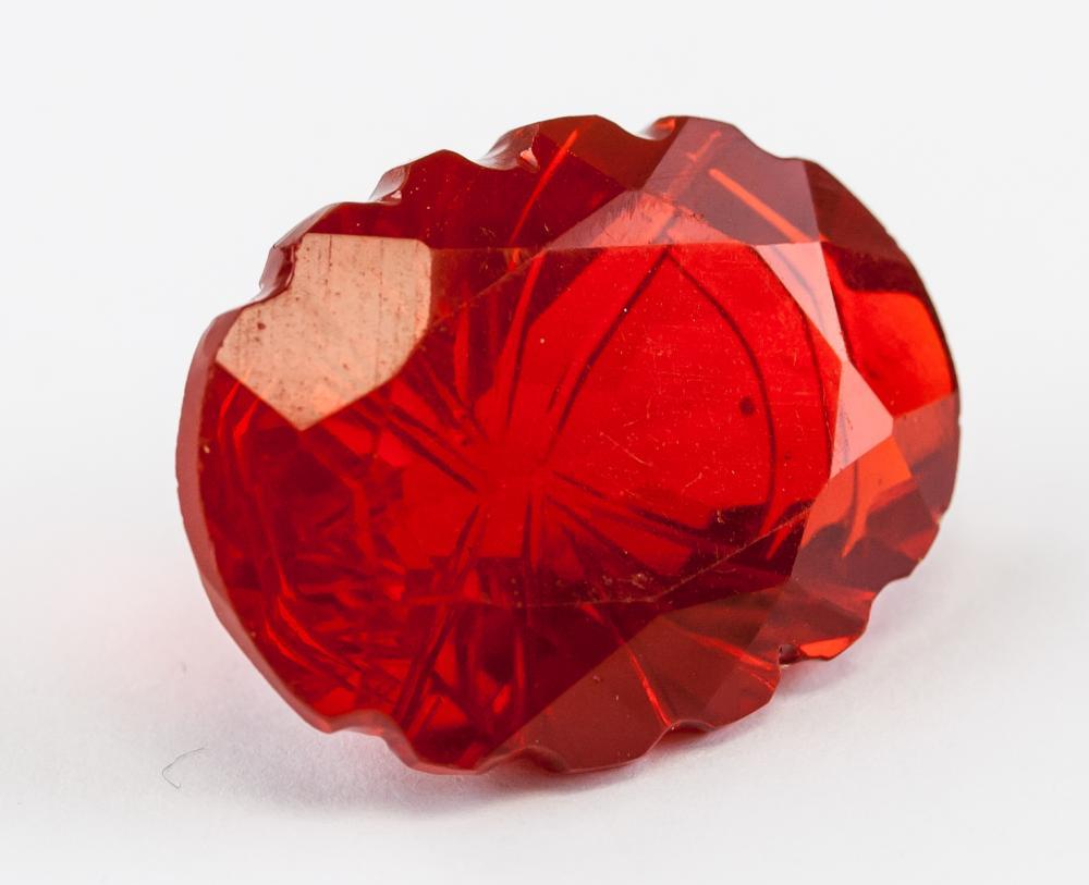 Lot 371: 36.85 ct Carving Cut Red Topaz GGL Certificate