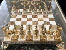 A GILT AND SILVERED BRONZE CHESS SET, VASARI