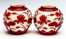 PAIR OF CHINESE RED CASED PEKING GLASS SPHERICAL VASES