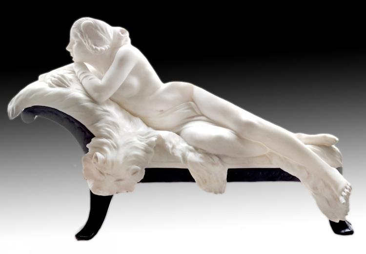 A carved marble figure of a reclining nude