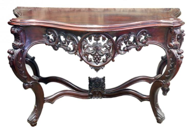 A SOUTHERN ITALIAN STYLE CARVED MAHOGANY CONSOLE TABLE