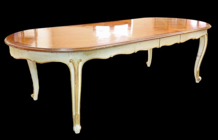 A LOUIS XV STYLE CARVED WOOD DINING TABLE