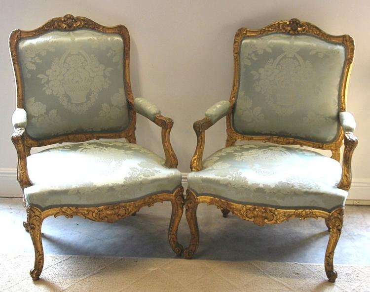 VERY FINE PAIR OF PARCEL-GILT ARM CHAIRS
