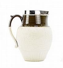 ENGLISH SILVER MOUNTED PARCEL-GLAZED POTTERY MILK JUG