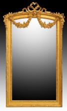 A LOUIS XVI STYLE 'MARIE ANTOINETTE' GILTWOOD MIRROR