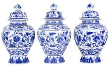FOUR BLUE AND WHITE PORCELAIN VASES WITH COVERS