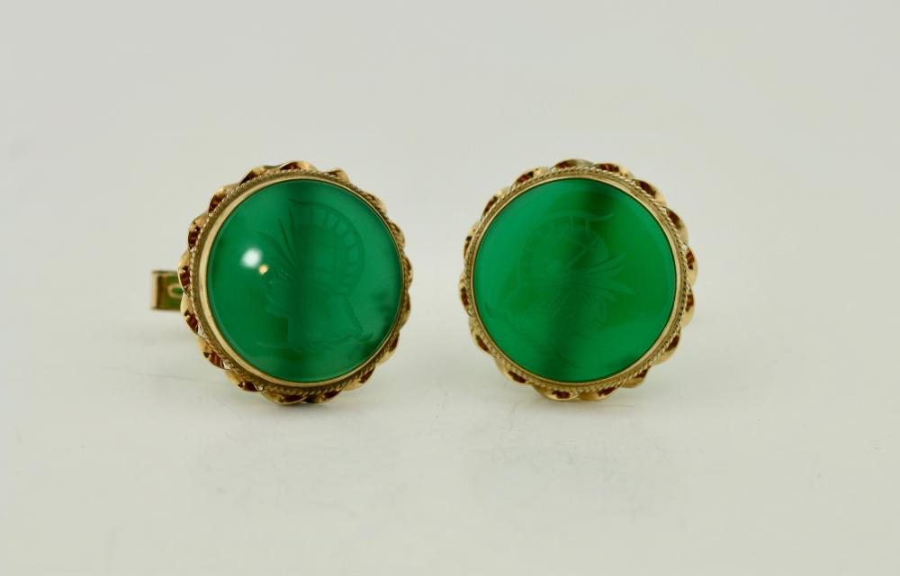 Lot 42: Pair of cufflinks, Set with carved chalcedony