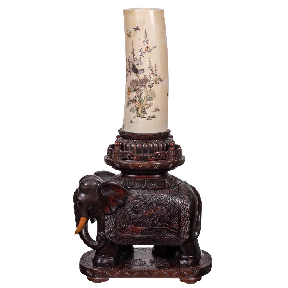 A Shibayama inlaid  vase atop a caparisoned elephant
