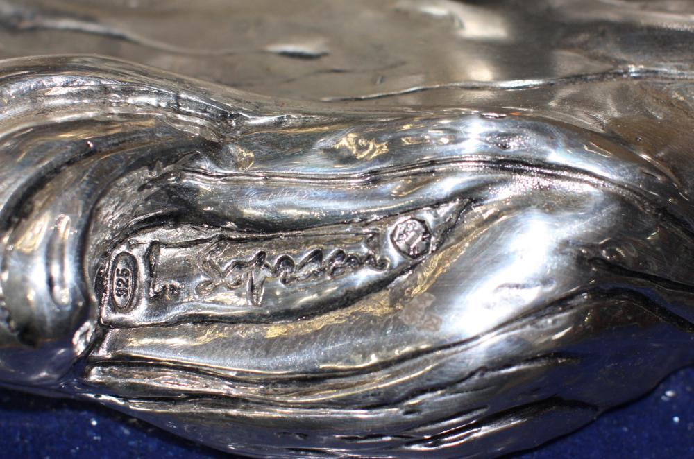 Lot 10: A Large silver group of dolphins, 20th century