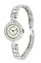 A FINE PLATINUM AND DIAMOND-SET BRACELET WATCH