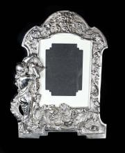 A LARGE SILVER PICTURE FRAME