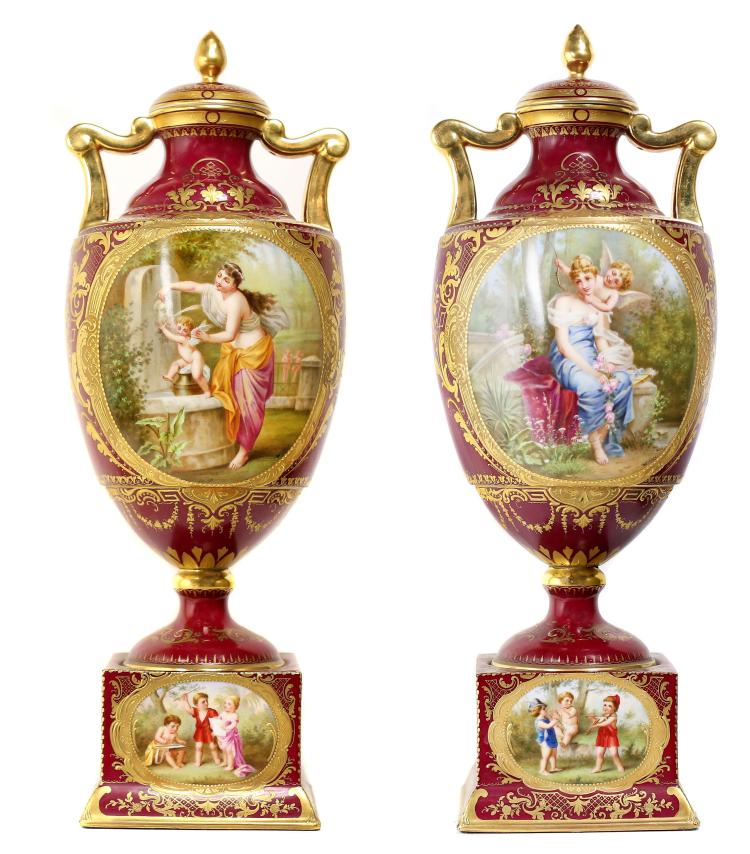 A FINE PAIR OF VIENNA STYLE PORCELAIN COVERED URNS