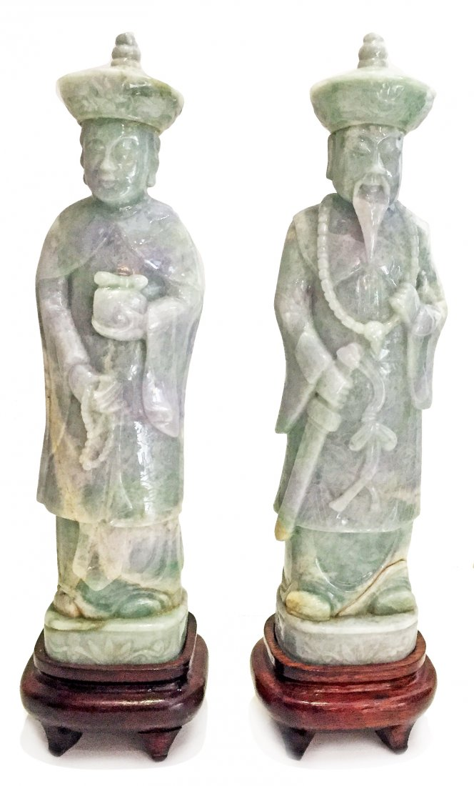 PAIR OF LIGHT LAVENDER JADE FIGURES OF A QUEEN AND KING