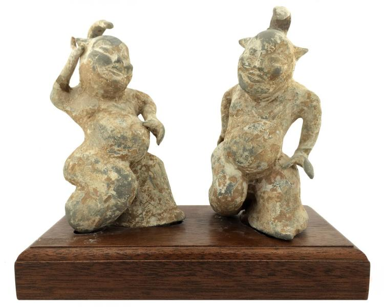 PAIR OF UN-GLAZED POTTERY ENTERTAINERS , CHINESE