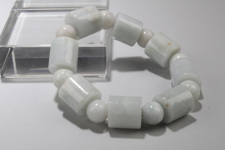 A 8-bead Burma Jade Curving Bracelet