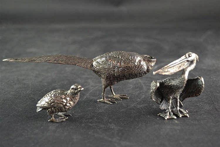 Zilveren dierfiguren