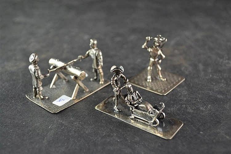 Zilveren miniatuur houtagers