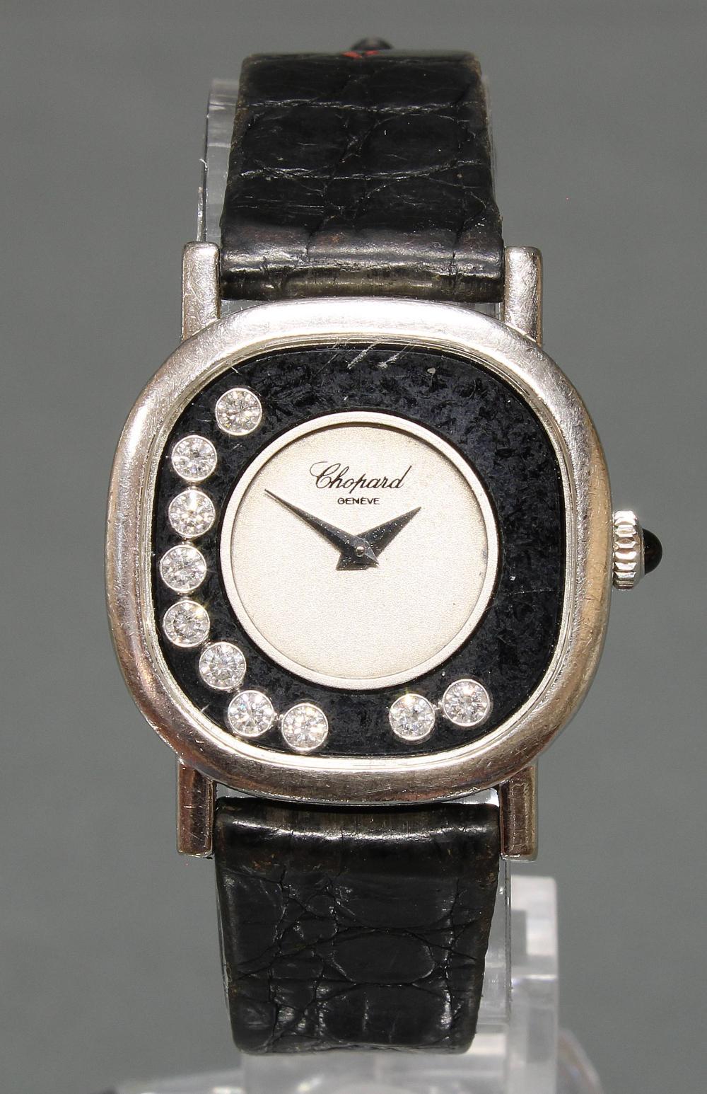 Damenarmbanduhr, Chopard, Modell 'Happy Diamonds', WG 750, Gehäuse-Nr. 132443/50895, Quarz, unter Glas auf dem Onyx-Ziffernring 10 bewegliche Brillanten, silberfarbenes Zifferblatt, funktionstüchtig (ohne Gewähr), original Krokoband mit Dornschließe