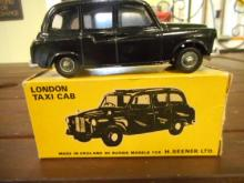 London Taxi Cab Budgie 101 w/orig box, toy car made in england for H seener ltd