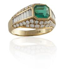AN EMERALD AND DIAMOND RINGThe collet-set emerald, within a baguette-cut and brilliant-cut diamond surround, mounted in 18K gold, diamonds approximately 1.60cts total, ring size JPlease note that this emerald was analysed by GCS laboratory in Lond