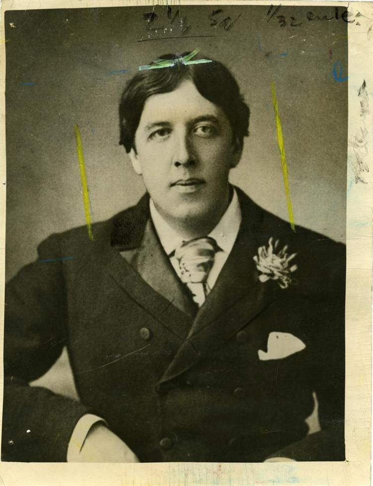 WILDE, OSCARPress photograph of Oscar Wilde dated 12 November 1949, stamped on verso 'Picture Library' with press cuttings also pasted on verso. 164 x 204mm.