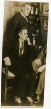 JOYCE, JAMESAn original photograph of James Joyce seated in conversation with another gentleman (cut away) and another gent in the background, photograph supplied by World Photos, Fleet Street, London, no date. 98 x 230mm. Fine.