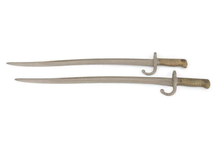 A PAIR OF FRENCH BRASS HANDLE BAYONETS, 19th century, with fullered blades and ribbed handgrips