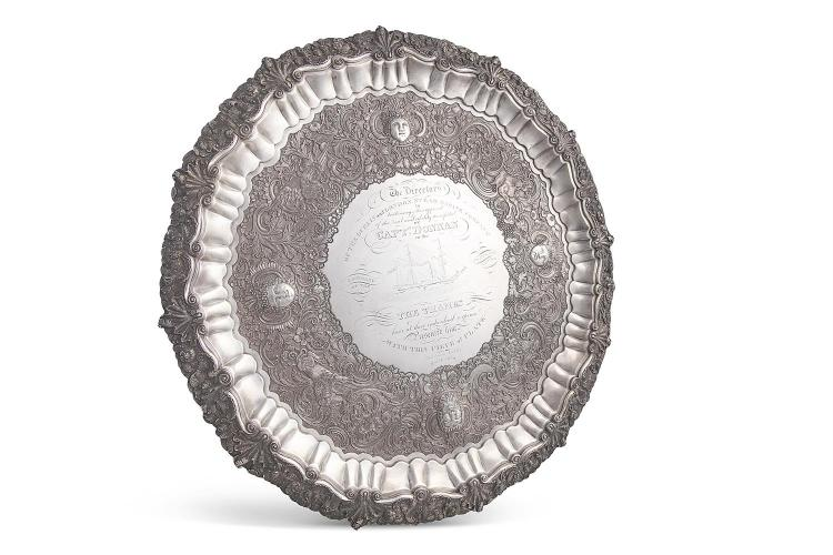 A FINE GEORGE IV IRISH SILVER PRESENTATION SALVER TO CAPTAIN DONNAN OF PADDLE STEAMER 'THAMES', Dublin 1824, mark of William Nolan, of large proportions, and shaped circular form, the central reserve simply engraved with a depiction of the steamer an