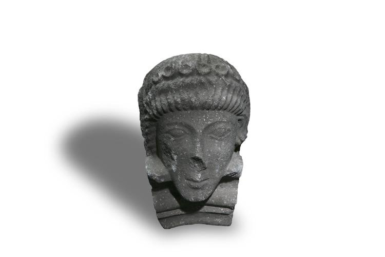 A CARVED STONE HEAD OF A CLASSICAL YOUTH, 28cm high, 17.5cm wideProvenance: Stackallen Co. Meath. See Elizabeth Hickey Journal of The Royal Society of Antiquaries.In similar fashion to the carved stone head of Catherine of Valois (Lot 67), found a