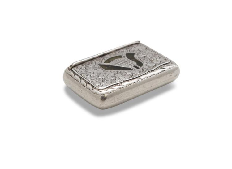 A SILVER SNUFF BOX PREVIOUSLY THE PROPERTY OF TOM CLARKE, Birmingham 1903, mark of Joseph Cook & Son, of rectangular form with integral hinged lid, decorated with an inlaid Connemara marble harp in a bed of chased and engraved shamrocks and enclosed