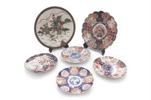 A COLLECTION OF ASSORTED JAPANESE IMARI DISHES, of varying sizes and designs, each decorated with alternating panels in blue, gilt and burnt orange tones, the largest 31cm diameter; together with a Chinese crackle ware dish, painted and enamelled wit