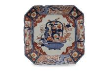 AN IMARI PORCELAIN PLATTER, of squared form with canted corners, decorated with basket of flowers in the typical palette of burnt orange and blue. 44 x 44cm