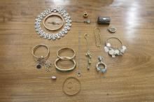 A LARGE COLLECTION OF SILVER AND GOLD JEWELLERY; comprising various gold bangles, a cameo brooch, chains, lockets, pendants etc.