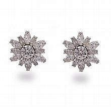 A pair of diamond earrings, each floral motif set