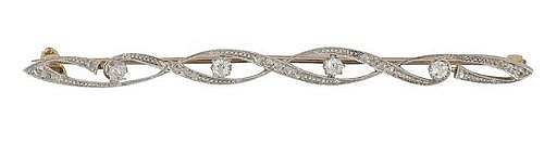 A diamond brooch, the scrolling design set