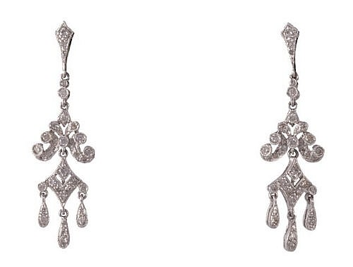 A pair of diamond earrings, each articulated