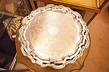 A LARGE SILVER PLATED SHAPED CIRCULAR SALVER, with