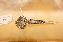 AN INDIAN WHITE METAL AND JEWELLED 'TURBIN' PIN