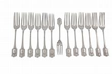A SET OF TWELVE AMERICAN STERLING SILVER TABLE FORKS, 1909, maker's mark of Shreve & Co., in the Shreve & Co. 'Adam Pattern', the handles terminating with neoclassical decoration and cartouches, some vacant, others with crests; together with a desser