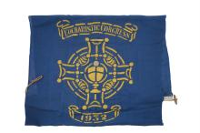 FREE STATE IRISH TRICOLOUR FLAG, circa 1920s, in three panels handstitched with rope socket machine stitched to one side. Very good condition. 74cms x 136cms; together with a Eucharistic Congress 1932, a large blue linen Flag, folded and white stitch
