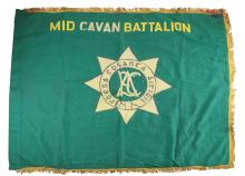 A MID CENTURY CAVAN BATTALION FLAG, in green trimmed gold edging