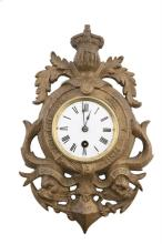 A  NAVAL-THEMED WALL CLOCK, with 3in enamel dial, with black steel hands and winding arbor to continental pendulum movement, contained within a cast-brass decorative mount, with Royal motto, dolphins and anchor. 12½  (32cm) high