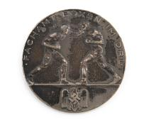 A  LARGE WHITE METAL PLATED MEDAL, obverse titled ?Fachamt Boxen Im  D.L.R.? with a pair of boxers in relief, over the German  eagle and swastika, the design signed HME, reverse engraved ?Landerkampf  / Irland-Deutschland  / 10.12.37.  Hamburg  /  De